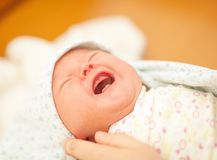 Newborn cries Royalty Free Stock Photography