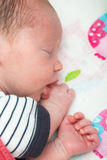 Newborn 8 days old baby sleeping in the crib Royalty Free Stock Images