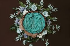 Free Newborn Digital Background - Brown Wooden Bowl With Green Leaves Wreath And  Teal Flowers Stock Photos - 190260113