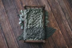 Free Newborn Digital Background - Dark Wooden Bed With Sage Green Knitted Blanket On Wooden Floor Stock Image - 191738201