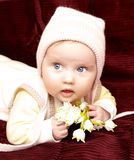 Newborn european baby girl boy with lily of walley 3 months old Royalty Free Stock Photo