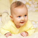 Newborn european baby girl boy smiling head up 3 months old Royalty Free Stock Image