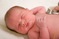 Newborn exam Stock Image