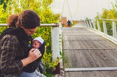 Newborn father together park baby carrier fatherhood background royalty free stock photos