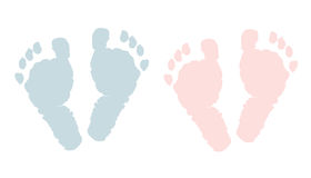 Newborn footprints. Baby girl and boy foots Royalty Free Stock Photography