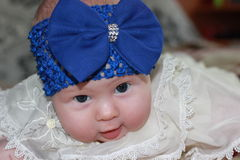 Newborn girl with big blue bow Royalty Free Stock Images