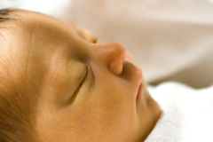 Newborn Girl Closeup Profile Stock Photo
