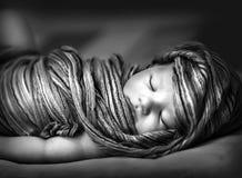 Newborn girl sleeping Royalty Free Stock Image
