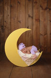 Newborn Girl Sleeping on the Moon Royalty Free Stock Image