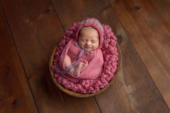 Newborn Girl Sleeping in Wooden Bowl Royalty Free Stock Images