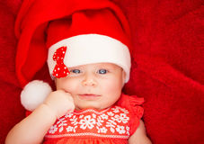 Newborn girl wear Santa hat Stock Photography
