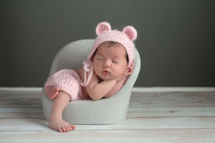 Newborn Girl Wearing a Pink Bear Hat