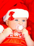 Newborn girl wearing Santa hat Royalty Free Stock Photography