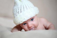 Newborn girl in white cap Royalty Free Stock Photography
