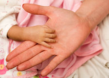 Newborn hand Stock Images