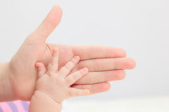 Newborn hand hold by parent Royalty Free Stock Photography