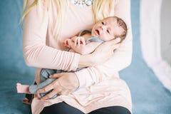 Newborn on hands at mum. Newborn two week on hands at mum. the concept of motherhood stock photography