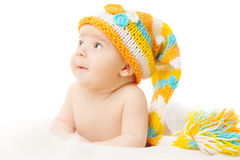 Newborn hat baby portrait in woolen cap over white background Royalty Free Stock Image