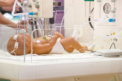 Newborn in a hospital bed Stock Photo