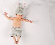 Newborn infant baby boy on a blanket. Newborn infant baby boy lying on a blanket in a bunny outfit Stock Photos