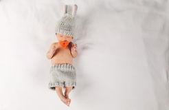 Newborn infant baby boy on a blanket. Newborn infant baby boy lying on a blanket in a bunny outfit Stock Image