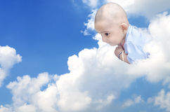 Newborn infant baby on clouds Royalty Free Stock Images