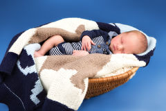 Newborn infant baby sleeping in a basket Stock Image