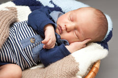 Newborn infant baby sleeping in a basket Royalty Free Stock Image