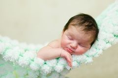 A newborn infant. The baby is sleeping lying on his stomach on a soft blanket Royalty Free Stock Images