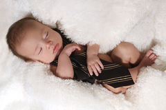 Newborn Infant Boy Sleeping on a Cute Set Stock Photography