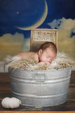 Newborn Infant Boy Sleeping on a Cute Set Stock Photos