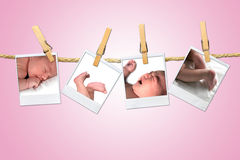 Newborn Infant Shots Hanging on a Rope With Clothe Stock Photo