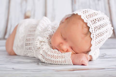 Newborn Infant sleeping. Newborn infant wearing nice homemade cap sleeping Royalty Free Stock Images