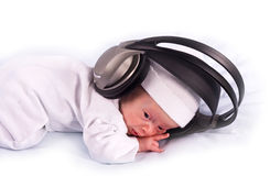 The newborn kid listening to music Royalty Free Stock Photo