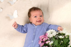 The newborn kid smiles Royalty Free Stock Photography