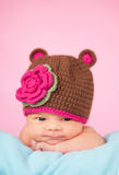 Newborn in knitted hat. Adorable newborn baby girl in knitted hat royalty free stock images