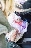 Newborn lay car seat mom change diapers travel babies Stock Photo