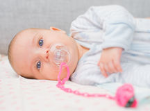 Newborn little baby with dummy. Stock Photography