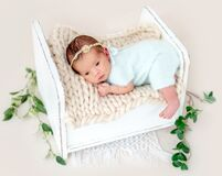 Newborn lying awake. Lovely newborn lying awake on tiny bed