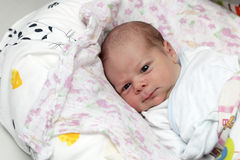 Newborn lying on the bed Stock Photography