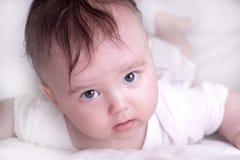Newborn lying on stomach Royalty Free Stock Photos
