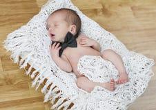 Newborn men. Newborn lying in the straw basket stock photo