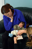 Newborn Metabolic Screening test. AUCKLAND - JUNE 09 2014:Midwife take blood sample from a newborn during metabolic screening test.Newborn screening samples are Stock Images
