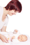 Newborn and mother Stock Images