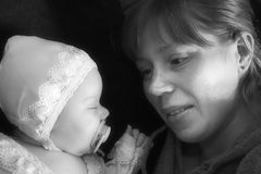 Newborn and mother black and white soft focus Royalty Free Stock Images