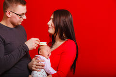 Newborn on mother chest, father brushing baby hair Royalty Free Stock Images