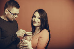 Newborn on mother chest, father brushing baby hair Stock Photos