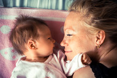 Newborn with mother looking at each other Stock Images
