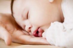 Newborn on mother's hands Stock Photos