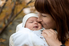 Newborn on the mother's hands in the park in autumn Royalty Free Stock Photography
